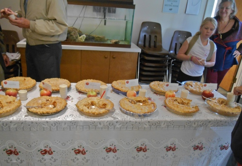 Chef Gerri Griswold, rear right, looks on as people sample her pies at White Memorial Conservation Center, Litchfield, Connecticut. (Bar Lois Weeks photo)