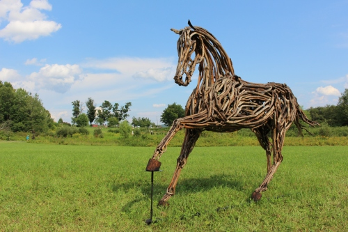 """Feed Me Apples,"" driftwood sculpture by Lindsey Molyneux, 2015 ""Art in the Orchard,"" Park Hill Orchard, Easthampton, Massachusetts. (Russell Steven Powell photo)"