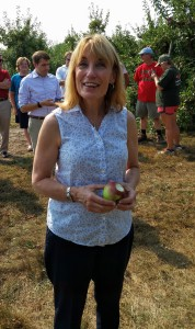 New Hampshire Gov. Maggie Hassan enjoys an apple at Mack's Apples in Londonderry, where she read her proclamation officially recognizing September as New England Apple Month. (Bar Lois Weeks photo)